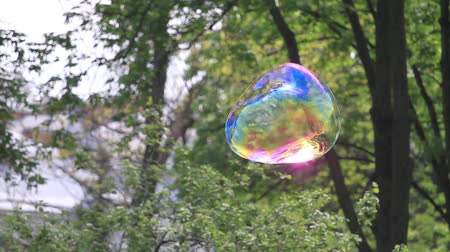 big soap bubble flies up then it bursts