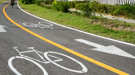 Cycling on bicycle lane outdoors, Cyclists using the designated bicycle lane