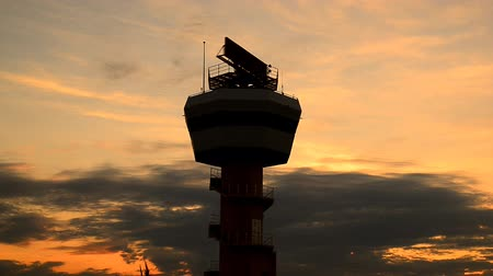 Air traffic control tower in sunset.