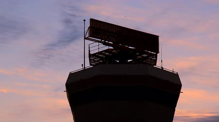 Air traffic control tower with airplane in sunset. Stok Video