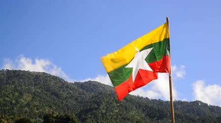 Flag of Myanmar (Burma) waving on hill Stok Video