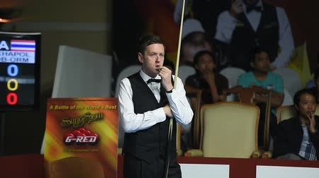 six worlds : Bangkok, Thailand - SEP 2:Ricky Walden of England participates in a Sangsom Six-red World Championship 2014 at Montien Riverside Hotel on September 2, 2014 in Bangkok, Thailand. Stock Footage