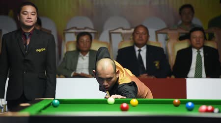 six worlds : Bangkok, Thailand - SEP 3:Dechawat Poomjaeng of Thailand participates in a Sangsom Six-red World Championship 2014 at Montien Riverside Hotel on September 3, 2014 in Bangkok, Thailand.