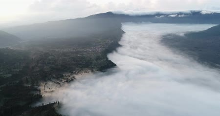 Aerial shot of Mountain Bromo active volcano crater in East Jawa, Indonesia. in the morning. drone fly above fog and cloud. start from view point to mountain Bromo. Dostupné videozáznamy