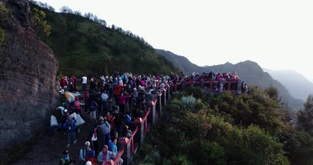 many tourist look at mount bromo from view point.