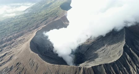 Aerial shot of Mountain Bromo active volcano crater in East Jawa, Indonesia. drone start in front of mountain Bromo and fly to top view crater of mountain bromo.
