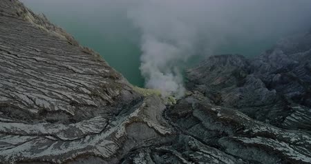Aerial shot from Kawah Ijien volcano crater. fly cross the crater to another mountain near Kawah Ijien. East Java, Indonesia.