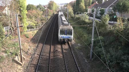 pylons : Suburban train approaching Stock Footage