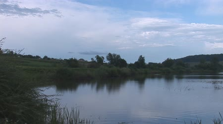pan : tranquil lake in the evening Stock Footage
