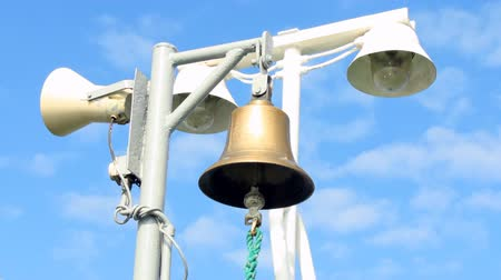 sinos : ships bell barely swaying in the wind