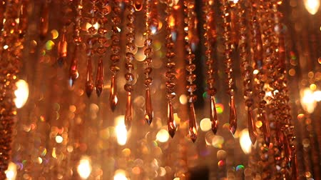 luxuriantly : large orange chandelier of glass with reflections