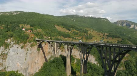 palmo : CIRCA, Montenegro - September 26: great bridge Durdevica Tara in the fall at which passing cars and tourists go in the European day of languages on September 26, 2017
