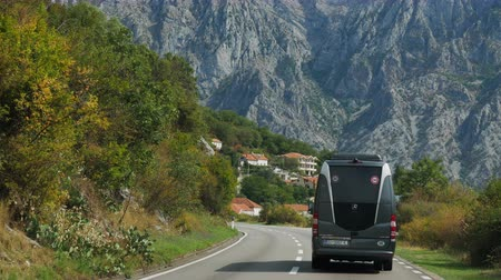 menetrend : Tivat, Montenegro - September 26: a passenger bus traveling on a mountain road in the European day of languages on September 26, 2017