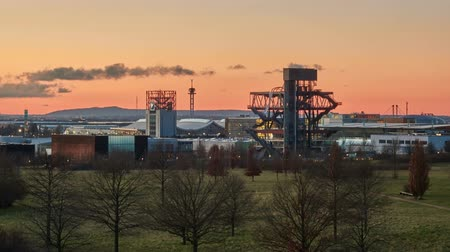 Silhouette of east territory of the exhibition center in Hanover in the January evening. Time lapse. 4K.