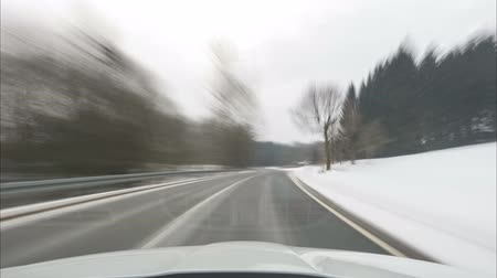 Time lapse of the movement on the car on the road through national park Harz in the winter. Lower Saxony. Germany. 4K