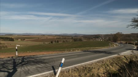 Time lapse of a car traffic on the field road around national park Harz in Germany. 4K.