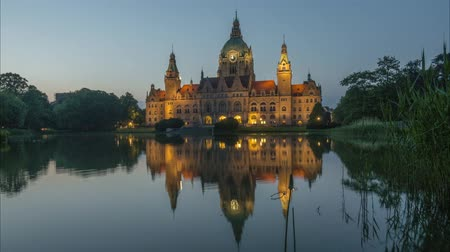 rathaus : New City Hall of Hannover reflecting in water in the evening. Time lapse. 4K.