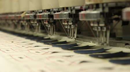 clothing :  industrial embroidery and sewing machine that working on the component part of footwear product