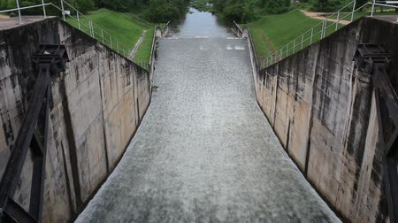 sluice : Water flowing from a dam at Dokkrai Reservoir Rayong, thailand