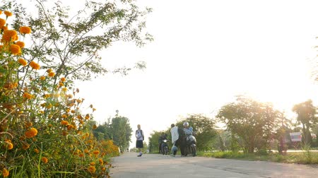 CHIANGRAI,THAILAND - NOVEMBER  13,2016: Unidentified kid boy and girl in uniform walking and riding bicycle to school in morning. Dostupné videozáznamy