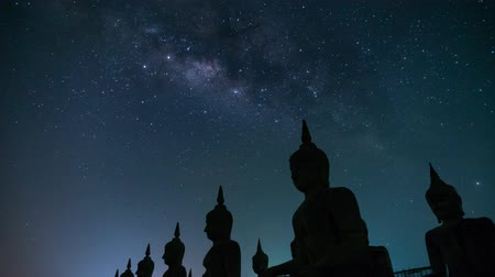 bab : Time lapse of big Buddha statue with milky way galaxy. in Nakhon si thammarat Province, Thailand Stock mozgókép