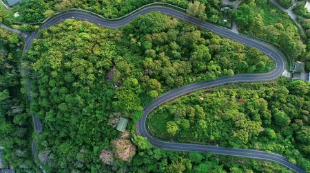 drive through : Aerial flight Drone flying over Curve road through the beautiful green rainforest Top view Aerial view from drone footage
