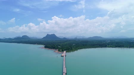 surat : Drone flying shot of Bridge in to the tropical sea and small island in summer time location of koh rat suratthani thailand