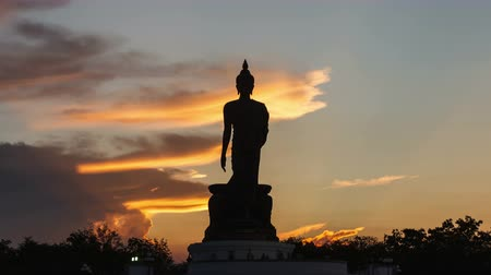 puja : 4K Time lapse, Sunset silhouette of the Buddha statue