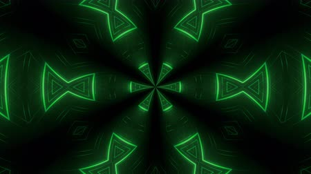 kmenový : Abstract tribal looping animated background. Seamless symmetric kaleidoscope backdrop from hypnotic rays. VJ style Flowing ornament footage.