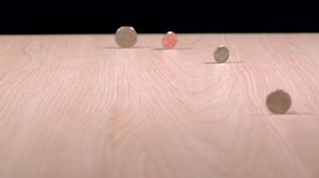 slow motion coins spinning on table