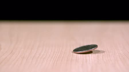 centavo : spinning quarter coming to rest Stock Footage