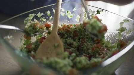 super bowl : people eating salad from bowl slow motion