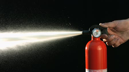peril : slow motion fire extinguisher going off Stock Footage