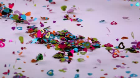 spilling : heart confetti blows away