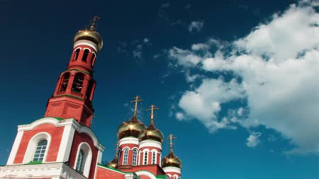 cassock : stunningly beautiful church of red brick with gold domes against the clear blue sky. timelapse Stock Footage