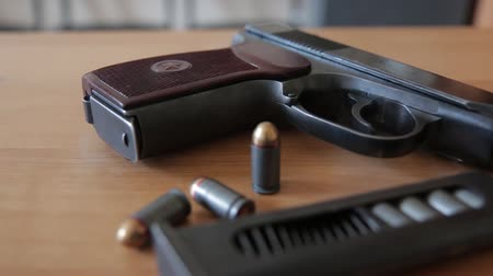 russian 9mm handgun PM Makarov on the table with holster, belt and empty pistol holder