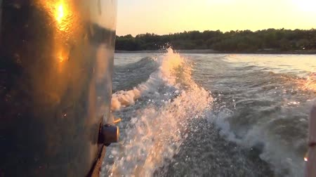 forage cutter with mounted engine, on the won the Wake at sunset Stock Footage