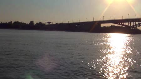 the town bridge over the river at sunset Stock Footage