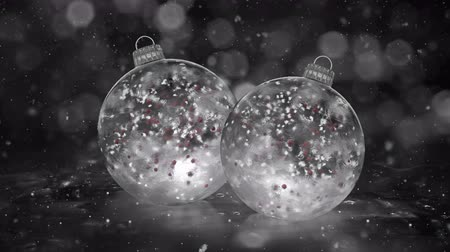 snow sparkle : Two Christmas and New Year White Balls Ice Glass Baubles Decorations with snowflakes and red balls inside. Perfect for wishing your viewers a Merry Christmas and a Happy New Year! Background 4k