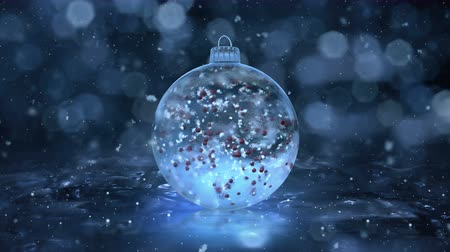 kar taneleri : Christmas and New Year Rotating Blue Ball Ice Glass Bauble Decoration with snowflakes and red balls inside. Perfect for wishing your viewers a Merry Christmas and a Happy New Year! Background 4k Stok Video