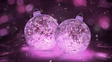 bombki : Two Christmas and New Year Pink Balls Ice Glass Baubles Decorations with snowflakes and red, pink, white petals inside. Perfect for wishing a Merry Christmas and a Happy New Year! Background 4k Wideo