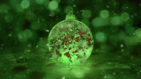 безделушка : Christmas and New Year Rotating Green Ball Ice Glass Bauble Decoration with snowflakes and red petals inside. Perfect for wishing a Merry Christmas and a Happy New Year! Background 4k