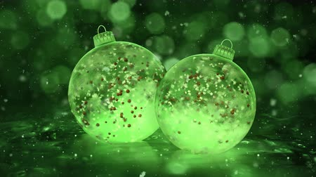 bombki : Two Rotating Christmas and New Year Green Balls Ice Glass Baubles Decorations with snowflakes and red balls inside. Perfect for wishing a Merry Christmas and a Happy New Year! Background 4k