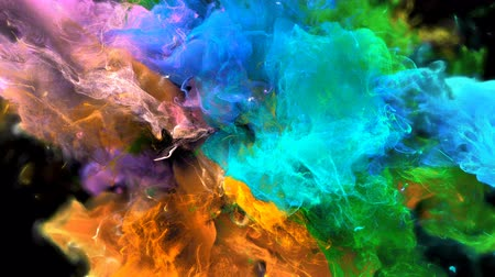 vibrující : Color Burst - colorful orange green blue pink smoke explosion fluid gas ink particles slow motion alpha matte isolated on black macro close-up