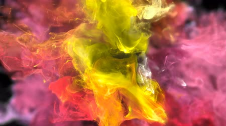 pop art background : Color Burst - colorful yellow pink orange red smoke explosion fluid gas ink particles slow motion alpha matte isolated on black macro close-up Stock Footage