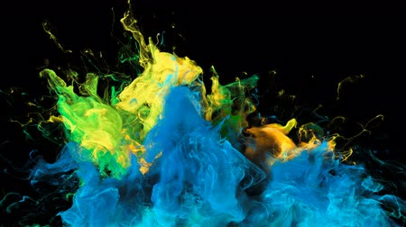 鮮やかな : Color Burst - colorful blue yellow green smoke explosion from below fluid gas ink particles slow motion alpha matte isolated on black
