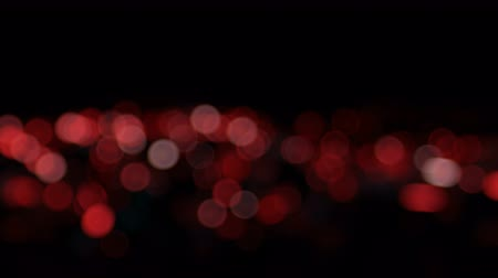 glistering : Red High quality animation of blurred abstract Christmas background with bokeh defocused lights. Seamless loop