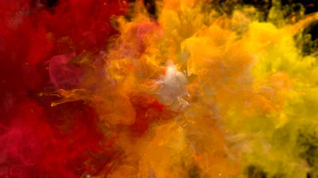 puder : Red Orange Yellow Color Burst - Multiple colorful smoke powder explosion fluid ink particles slow motion alpha matte isolated on black