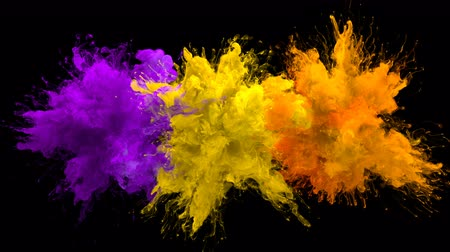 kitörés : Purple Yellow Orange Color Burst - Multiple colorful smoke powder explosion fluid ink particles slow motion alpha matte isolated on black