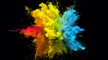 sıçrama : Color Burst iridescent multicolored colorful rainbow smoke powder explosion fluid ink particles slow motion alpha matte isolated on black Stok Video